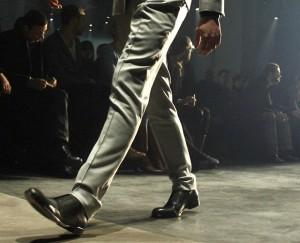 A model presents fashion of the men's fa